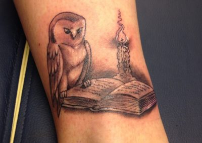 owl-reading-by-candle wrist